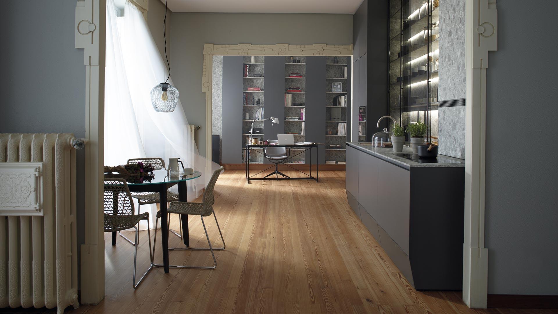 Cocina lineal abierta a comedor y estudio Santiago Interiores